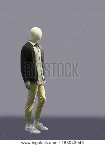 Full-length male mannequin dressed in casual clothes (jumper and trousers) isolated. No brand names or copyright objects.