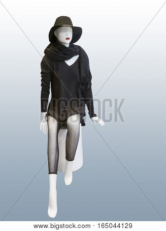 Sitting female mannequin wearing black dress hat and fishnet leggings isolated. No brand names or copyright objects.