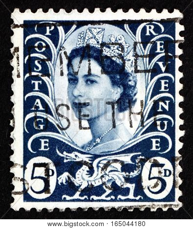 GREAT BRITAIN - CIRCA 1968: a stamp printed in the Great Britain shows Her Majesty the Queen Elizabeth II Portrait and Welsh Dragon circa 1968