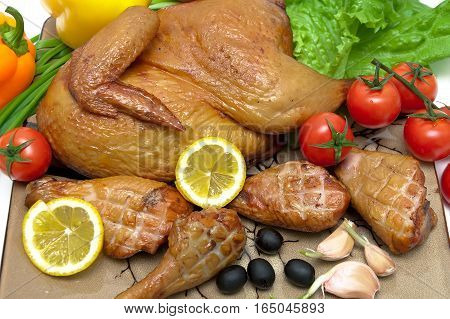 delicious grilled chicken with vegetables and lemon. horizontal photo.