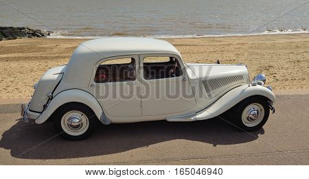 FELIXSTOWE, SUFFOLK, ENGLAND - MAY 01, 2016: Classic White Citroen car parked on seafront promenade.