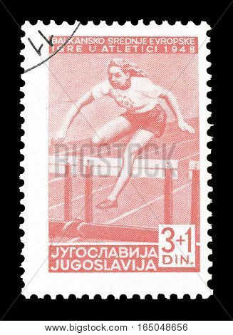 YUGOSLAVIA - CIRCA 1948 : Cancelled postage stamp printed by Yugoslavia, that shows Hurdle race.