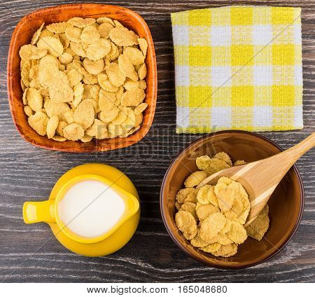 Corn Flakes In Bowls, Napkin And Jug Milk On Table
