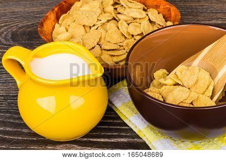 Corn Flakes, Jug Milk And Brown Bowl On Table