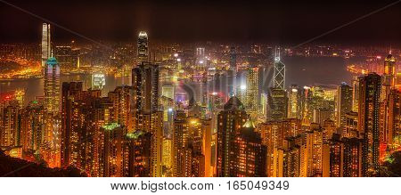 Panorama of Hong Kong, China. Spectacular night view of Victoria Harbour skyline from Victoria Peak. The Peak is the highest mountain in Hong Kong Island.