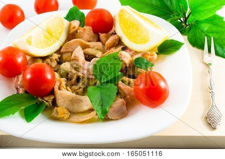 Salad Of Blanched Pieces Of Seafood On A White Plate Close-up