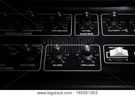 Vintage Analogue Synth Control Panel Closeup In Shallow Focus