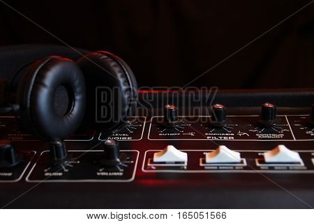 Headphones On The Panel Of An Old Vintage Synthesizer