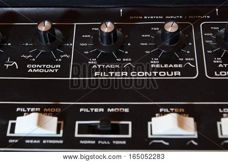 Vintage Analogue Music Synthesizer Control Panel Closeup In Shallow Focus