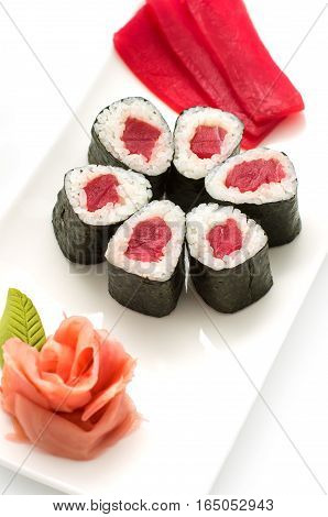 Simple maki sushi rolls isolated on white. Just nori rice and tuna