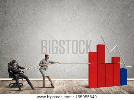 Young man and woman making huge graph growth move