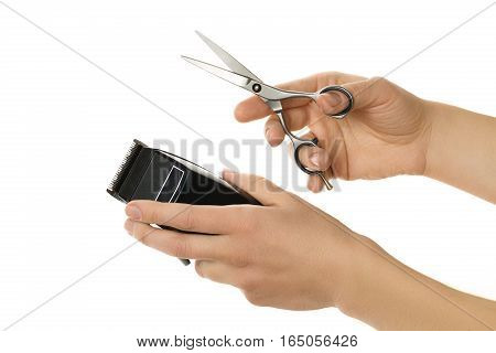 Closeup image of hands holding hair clipper and scissor, isolated on white background