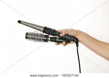 Barber Hand holdinr curling hair and comb.