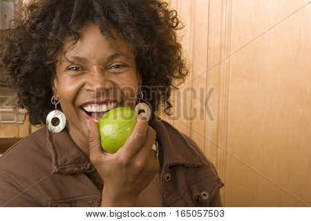 Portrait of a happy African American woman smiling at home.