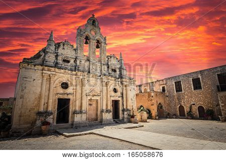 Stunning sunset over Arkadi monastery on Crete island, Greece. Ekklisia Timios Stavros - Moni Arkadiou in Greek. It is a venetian baroque church.