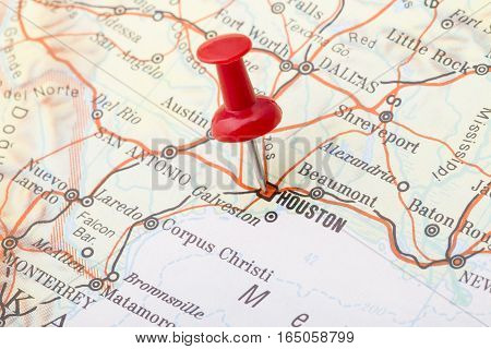 Close up of Houston map with red push pin.