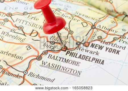 Close up of Philadelphia map with red push pin.