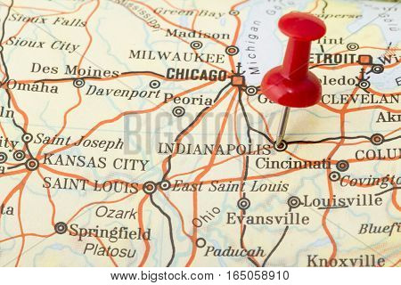 Close up of Indianapolis map with red push pin.