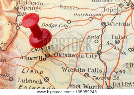 Close up of Oklahoma City map with red push pin.