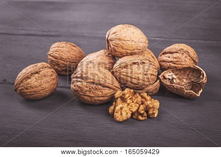 Walnuts isolated on a dark wooden table