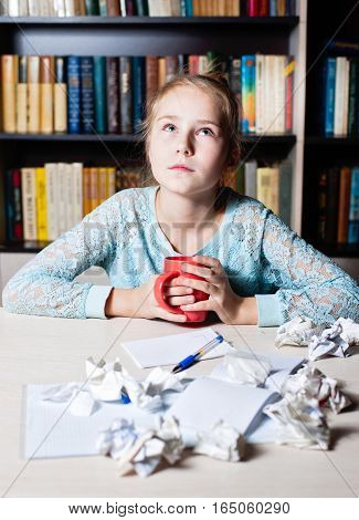 Young Girl With Writers Block Staring Thoughtfully