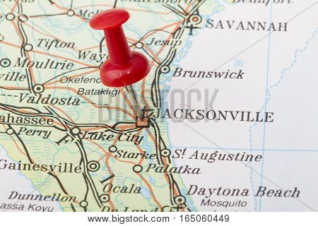 Close up of Jacksonville map with red push pin.