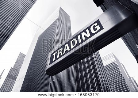 trading sign in front of office buildings
