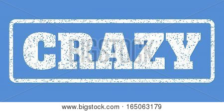 White rubber seal stamp with Crazy text. Vector tag inside rounded rectangular shape. Grunge design and dirty texture for watermark labels. Horisontal emblem on a blue background.