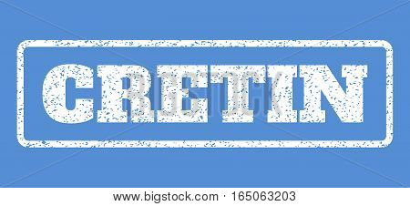 White rubber seal stamp with Cretin text. Vector message inside rounded rectangular frame. Grunge design and scratched texture for watermark labels. Horisontal sticker on a blue background.