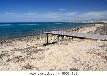Kato Paphos beach with wooden pierrelax place on the Cyprus sea coast