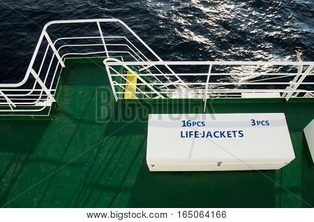 white box with life jackets on deck of passenger liner