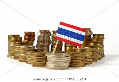 Thailand Flag Waving With Stack Of Money Coins