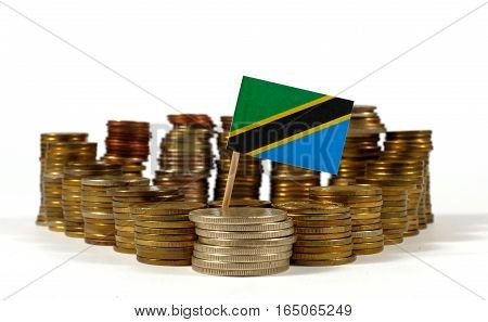 Tanzania Flag Waving With Stack Of Money Coins