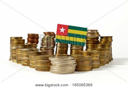 Togo Flag Waving With Stack Of Money Coins