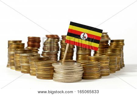 Uganda Flag Waving With Stack Of Money Coins