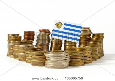Uruguay Flag Waving With Stack Of Money Coins
