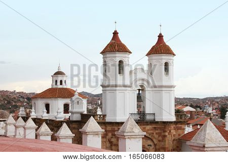 Sucre Bolivia - December 7 2016: Bell tower and cupola of San Felipe Neri Monastery with view of Sucre Bolivia on December 7 2016