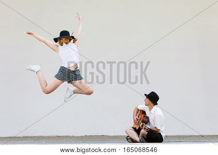 Man Playing Guitar, Woman Having Fun