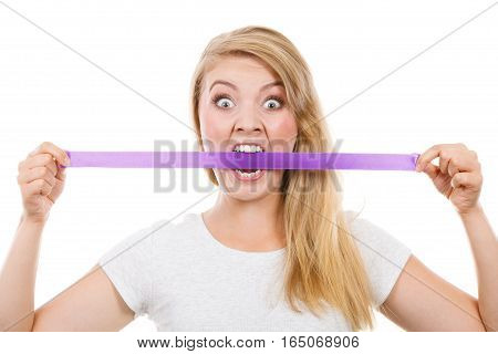Attractive Blonde Woman Biting Tape On Mouth.