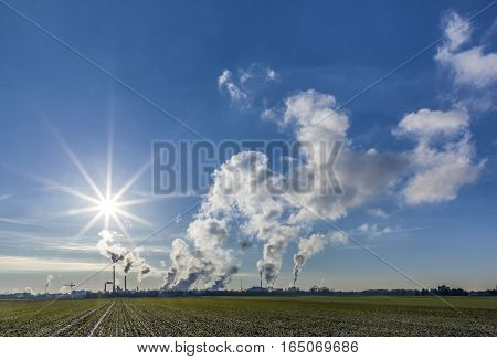 Chimneys With Smoke Of An Industrial Area