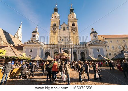 Traditional Christmas Market In Duomo Square With Scenic View Of The Cathedral.