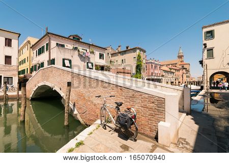 Typical Bridge Across A Canal In Chioggia, Venice, Italy.
