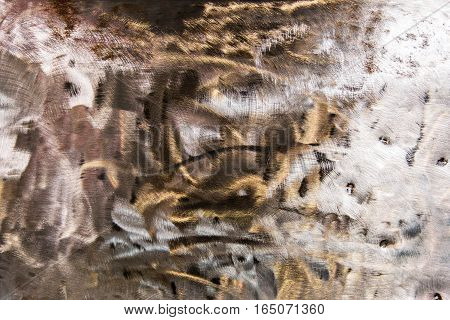 Background formed by bright scratched sheet steel.