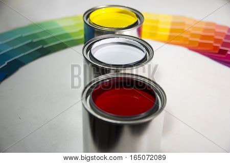 Opened paint Cans  with various colors and colorful paint samples on white background. Paint, Cans, Painting, Samples, Colors