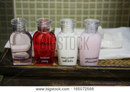 The Hotel amenities kit spa soap and shampoo in vintage bathroom