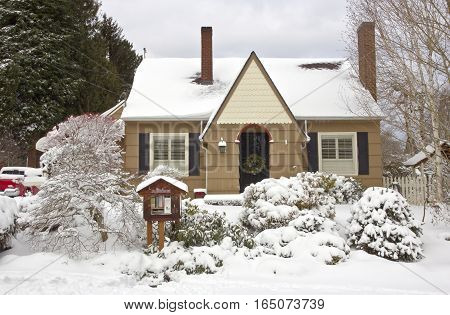 Family home and snow covered ground Gresham Oregon.