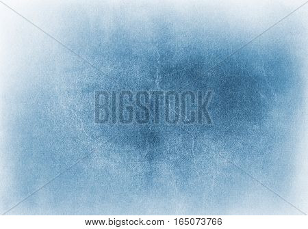 A blue and cyan grunge background with heavy paper textures and a light vignette effect. Image has crack patterns and significantly coarse grain.