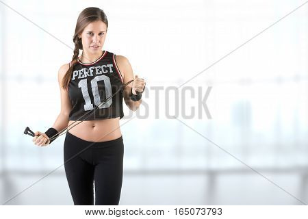 Sporty Woman With A Jumping Rope, Isolated In White