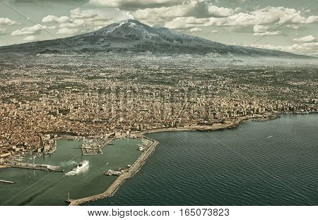Air photo of Catania city in Sicily with the Etna Vulcan in the back. (HDR image with black gold filter)