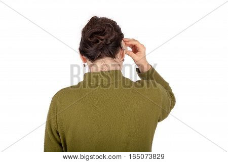 The Woman is inserting a hearing aid